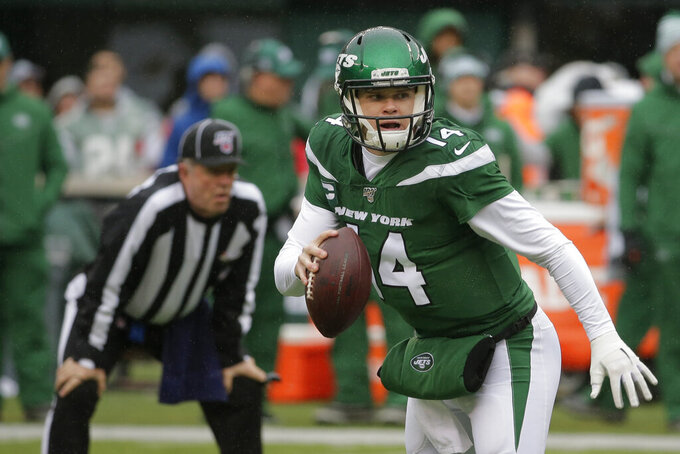 New York Jets quarterback Sam Darnold (14) looks to pass during the first half of an NFL football game against the Oakland Raiders Sunday, Nov. 24, 2019, in East Rutherford, N.J. (AP Photo/Seth Wenig)