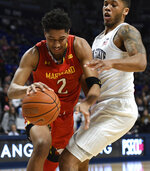 Maryland guard Aaron Wiggins, left, tries to get around Penn State guard Myles Dread, right, during the first half of an NCAA college basketball game Wednesday, Feb. 27, 2019, in State College, Pa. (AP Photo/John Beale)