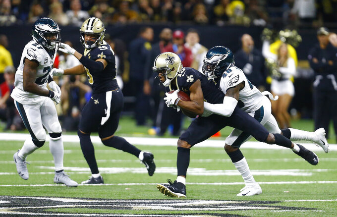 New Orleans Saints wide receiver Michael Thomas (13) makes the catch against Philadelphia Eagles cornerback Josh Hawkins (48) in the second half of an NFL divisional playoff football game in New Orleans, Sunday, Jan. 13, 2019. (AP Photo/Butch Dill)