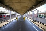 Employees of the Russian Emergency Situations disinfect a platform of Liningradsky railway station in Moscow in Moscow, Russia, Thursday, July 22, 2021. Russia has been facing a sharp increase in coronavirus infections in recent weeks, with the daily tally of confirmed cases going from about 9,000 in early June to over 25,000 in mid-July. On Thursday, the country's state coronavirus task force reported 24,471 new infections and 796 deaths. (AP Photo/Alexander Zemlianichenko)
