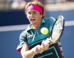 Alexander Zverev of Germany hits a backhand to Stefanos Tsitsipas of Greece in Rogers Cup quarterfinal tennis tournament action in Toronto onFriday, Aug. 10, 2018. (Frank Gunn/The Canadian Press via AP)