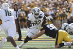 Colorado State running back Marcus McElroy Jr. (32) is tackled by Iowa defensive lineman John Waggoner (92) during the first quarter of an NCAA college football game, Saturday, Sept. 25, 2021, in Iowa City, Iowa. (AP Photo/Ron Johnson)