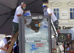 CORRECTING NAME TO KOEBERL - Austrian ice swimmer Josef Koeberl is standing in a glass cabin filled with ice try to break the world record for a human to stay side an ice box in Melk, Saturday, Sept. 5, 2020. (AP Photo/Ronald Zak)