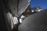 "FILE - The bobsled track in Cortina d'Ampezzo, Italy, is shown in this Wednesday, Feb. 17, 2021 file photo. The International Olympic Committee reluctantly accepted plans to spend 50 million euros ($60 million) to rebuild an abandoned bobsled track in Cortina d'Ampezzo for the 2026 Winter Games — as long as the funds stay out of the games' budget. After the IOC's periodic coordination commission visit Monday, April 19, 2021 which was held virtually, the Olympic body said it ""again expressed its concerns with regard to the legacy of the track."" The century-old track in Cortina was closed 13 years ago for financial reasons. (AP Photo/Gabriele Facciotti, File)"
