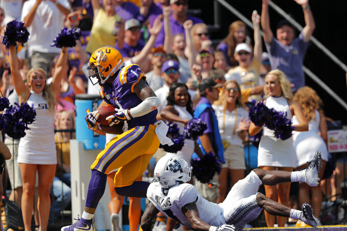 LSU wide receiver Ja'Marr Chase (1) pulls in a touchdown reception against Utah State cornerback DJ Williams in the first half of an NCAA college football game in Baton Rouge, La., Saturday, Oct. 5, 2019. (AP Photo/Gerald Herbert)