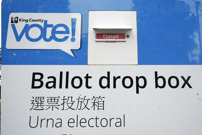 A King County ballot drop box, closed until ballots are mailed about three weeks before the election, stands on a Seattle street Thursday, Sept. 24, 2020. (AP Photo/Elaine Thompson)