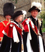 FILE - In this June 15, 1998 file photo, Britain's Queen Elizabeth II and her husband Prince Philip, right, lead the annual procession of members of the Order of the Garter from Windsor Castle to St. George's Chapel in Windsor, England. Buckingham Palace says Prince Philip, husband of Queen Elizabeth II, has died aged 99. (AP Photo/Alastair Grant, File)