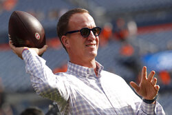 Former Denver Broncos quarterback Peyton Manning throws a football prior to an NFL preseason football game against the San Francisco 49ers, Monday, Aug. 19, 2019, in Denver. (AP Photo/David Zalubowski)