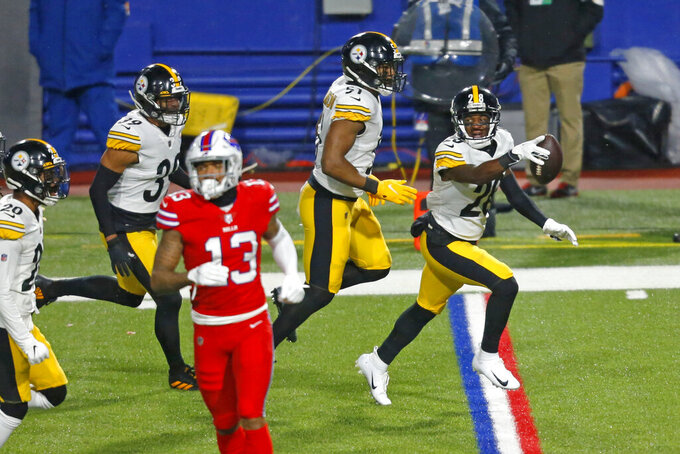 Pittsburgh Steelers cornerback Mike Hilton (28) celebrates after intercepting a pass by Buffalo Bills quarterback Josh Allen (17) during the first half of an NFL football game in Orchard Park, N.Y., Sunday, Dec. 13, 2020. (AP Photo/Jeffrey T. Barnes )