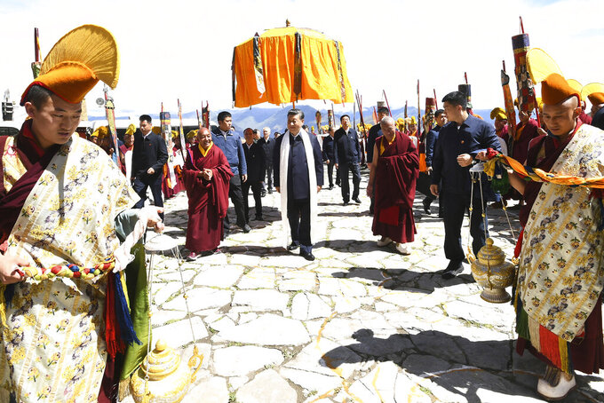 In this July 22, 2021, photo released by China's Xinhua News Agency, Chinese President Xi Jinping, center, visits the Drepung Monastery near Lhasa in western China's Tibet Autonomous Region. Chinese leader Xi Jinping has made a rare visit to Tibet as authorities tighten controls over the Himalayan region's traditional Buddhist culture, accompanied by an accelerated drive for economic development. (Xie Huanchi/Xinhua via AP)