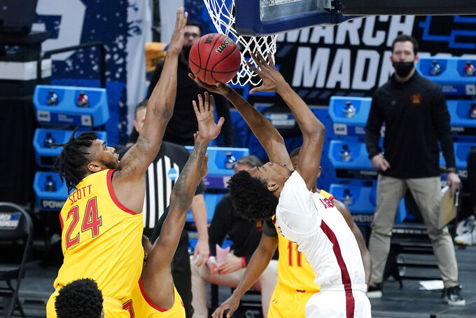 Alabama's Herbert Jones, right, shoots as Maryland's Donta Scott (24) reaches for the ball during the first half of a college basketball game in the second round of the NCAA tournament at Bankers Life Fieldhouse in Indianapolis Monday, March 22, 2021. (AP Photo/Mark Humphrey)