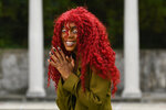 """This Aug. 19, 2019 photo shows music artist Buku Abi, born Joann Kelly, posing in Atlanta. As the daughter of R. Kelly, she experienced her fair share of hardships. She is no longer in touch with him and says being R. Kelly's daughter is like """"a double-edged sword."""" In March, Abi released her debut EP """"Don't Call Me"""" and she appeared on the WEtv reality series, """"Growing Up Hip Hop: Atlanta."""" (AP Photo/John Amis)"""