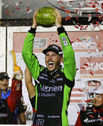 Ross Chastain celebrates in Victory Lane after winning the NASCAR Xfinity Series auto race at Daytona International Speedway, early Saturday, July 6, 2019, in Daytona Beach, Fla. (AP Photo/Terry Renna)