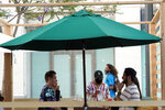 A server tends to customers in an outdoor dining area amid the COVID-19 pandemic on The Promenade Wednesday, June 9, 2021, in Santa Monica, Calif. (AP Photo/Marcio Jose Sanchez)