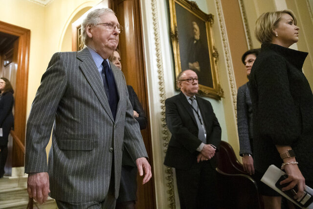 Senate Majority Leader Mitch McConnell of Ky., walks from the Senate Chamber after the delivery of the articles of impeachment against President Donald Trump to Secretary of the Senate Julie Adams on Capitol Hill in Washington, Wednesday, Jan. 15, 2020. (AP Photo/Matt Rourke)