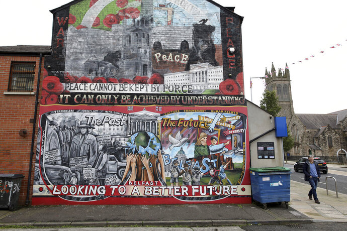 "FILE - In this Tuesday, Oct. 15, 2019 file photo showing a Loyalist mural painted on a wall in east Belfast, Northern Ireland. Rory Finnis was only 21 years old when he was killed in 1991 by the Irish Republican Army. Accused of ""informing"" the Northern Ireland government of the paramilitary group's activities, the boy from Londonderry was shot in the head. His hands had been tied behind his back and his eyes taped closed. Details of Finnis' death, along with many others, have been revealed in archives newly opened by the Public Records Office of Northern Ireland. The files concern the violent period known as ""The Troubles"", which centred on whether Northern Ireland would be part of the United Kingdom, as it is today, or join the Republic of Ireland. (AP Photo/Peter Morrison, File)"