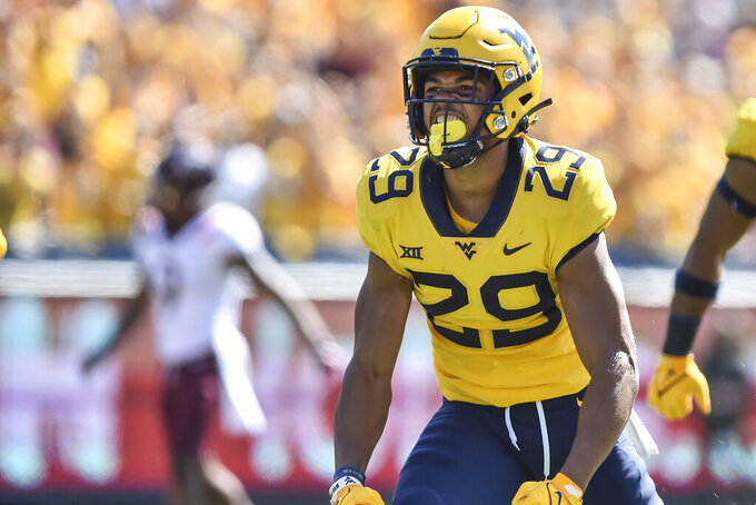 West Virginia safety Sean Mahone (29) reacts after making a play against Virginia Tech during the first half of an NCAA college football game in Morgantown, W.Va., Saturday, Sep. 18, 2021. (AP Photo/William Wotring)