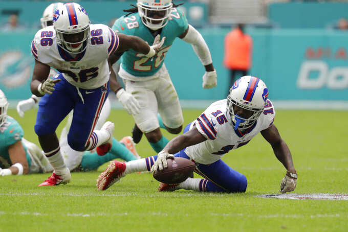 Buffalo Bills wide receiver John Brown (15) recovers a fumble by Buffalo Bills running back Devin Singletary (26), during the first half at an NFL football game against the Miami Dolphins, Sunday, Nov. 17, 2019, in Miami Gardens, Fla. (AP Photo/Lynne Sladky)