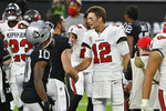 Tampa Bay Buccaneers quarterback Tom Brady (12) greets Las Vegas Raiders quarterback Derek Carr (4) after an NFL football game, Sunday, Oct. 25, 2020, in Las Vegas. (AP Photo/David Becker)