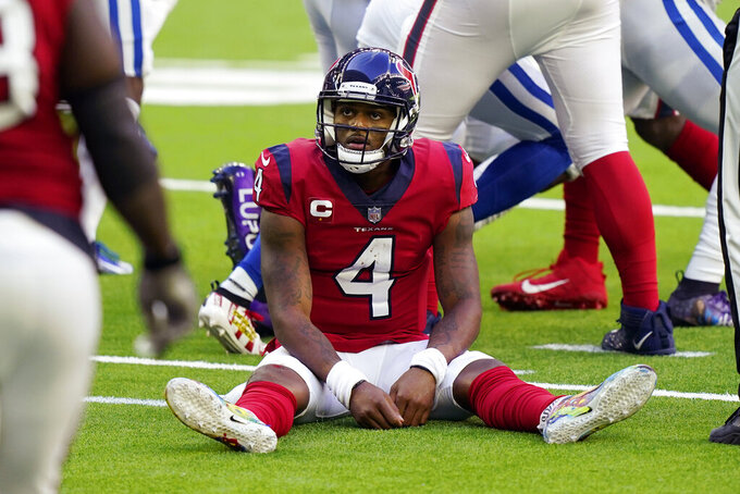 Houston Texans quarterback Deshaun Watson (4) sits on the turf after losing a fumble to the Indianapolis Colts during the second half of an NFL football game Sunday, Dec. 6, 2020, in Houston. (AP Photo/David J. Phillip)