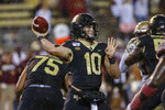 FILE - In this Saturday, Oct. 19, 2019, file photo, Wake Forest quarterback Sam Hartman looks to pass against Florida State in the second half of an NCAA college football game in Winston-Salem, N.C. The Demon Deacons have been to four straight bowl games but will have to overcome significant personnel losses on offense in coach Dave Clawson's seventh season. (AP Photo/Nell Redmond, File)
