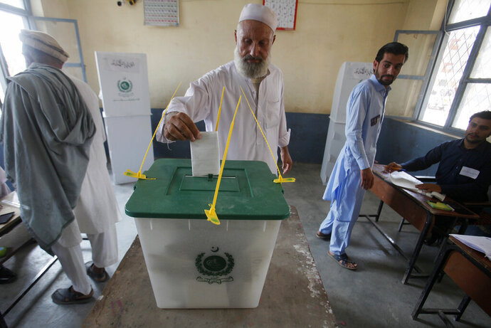 A Pakistani tribesman cast his vote during an election for provincial seats in Jamrud, a town of Khyber district, Pakistan, Saturday, July 20, 2019. Pakistan's northwestern tribal areas are holding their first-ever provincial elections. The seven tribal areas were merged last year as tribal districts into the northwestern Khyber Pakhtunkhwa province. Before that, the tribal areas were federally administered, and residents could only vote in the national assembly. (AP Photo/Muhammad Sajjad)