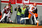 Clemson's Travis Etienne (9) breaks away from North Carolina State's Tanner Ingle (10) to score during the first half of an NCAA college football game in Raleigh, N.C., Saturday, Nov. 9, 2019. (AP Photo/Karl B DeBlaker)
