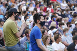 Guests listen as Sen. Bernie Sanders, I-Vt., speaks during town hall at Tippecanoe County Amphitheater, Friday, Aug. 27, 2021, in West Lafayette, Ind. The Vermont senator is in Trump country this weekend, promoting a budget plan packed with progressive initiatives and financed by higher taxes on top earners. (AP Photo/Darron Cummings)