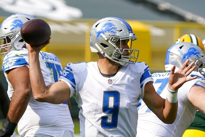 Detroit Lions' Matthew Stafford throws during the second half of an NFL football game against the Green Bay Packers Sunday, Sept. 20, 2020, in Green Bay, Wis. (AP Photo/Morry Gash)
