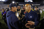 Penn State coach James Franklin, right, and Michigan coach Jim Harbaugh, left, meet after an NCAA college football game in State College, Pa., Saturday, Oct. 19, 2019. Penn State won 28-21. (AP Photo/Gene J. Puskar)