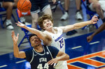 Boise State center Lukas Milner reaches for a rebound over Utah State guard Marco Anthony during the second half of an NCAA college basketball game Wednesday, Feb. 17, 2021 at ExtraMile Arena in Boise, Idaho. (Darin Oswald/Idaho Statesman via AP)