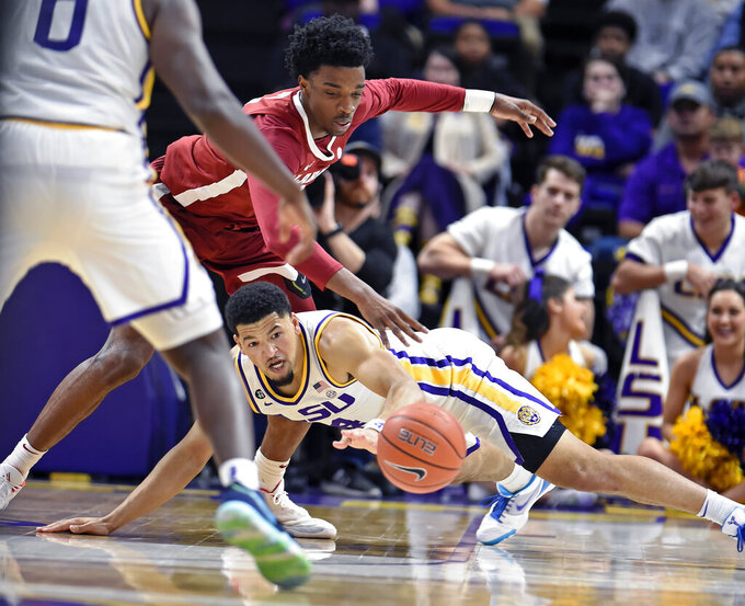 LSU guard Skylar Mays (4) chases after a loose ball as Alabama guard Herbert Jones, top, pressures in the second half of an NCAA college basketball game, Wednesday, Jan. 29, 2020, in Baton Rouge, La. LSU won 90-76. (AP Photo/Bill Feig)