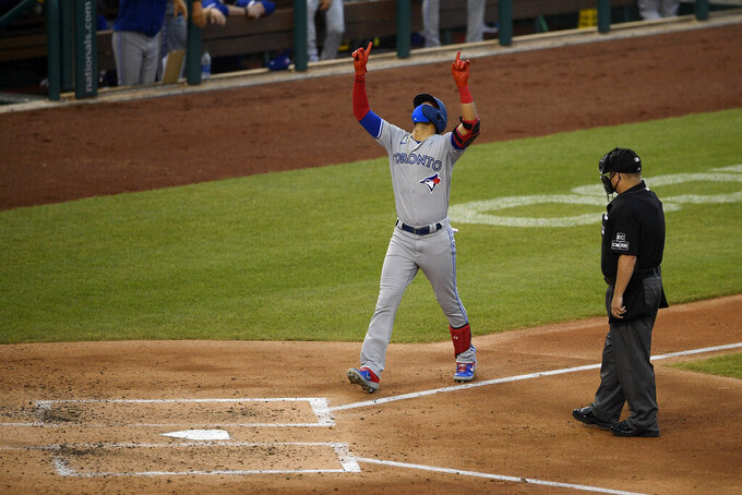 Toronto Blue Jays' Lourdes Gurriel Jr. celebrates his home run during the fourth inning of a baseball game against the Washington Nationals, Tuesday, July 28, 2020, in Washington. (AP Photo/Nick Wass)