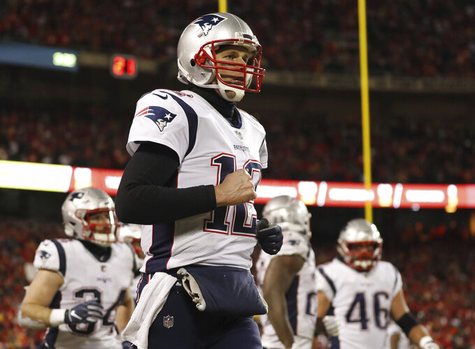 New England Patriots quarterback Tom Brady (12) celebrates a touchdown during the second half of the AFC Championship NFL football game against the Kansas City Chiefs, Sunday, Jan. 20, 2019, in Kansas City, Mo. (AP Photo/Jeff Roberson)