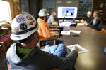 In this March 5, 2020, photo, miners go through a bird identification exercise before they start their shift for Montana Resources in Butte, Montana. The Trump administration is moving to scale back criminal enforcement of a century-old law protecting most American wild bird species. Mark Thompson, the manager of environmental affairs at Montana Resources, said it would keep up the efforts that drive away almost all birds regardless of the Trump administration's actions, mirroring pledges from some other companies and industries. (Meagan Thompson/The Montana Standard via AP)