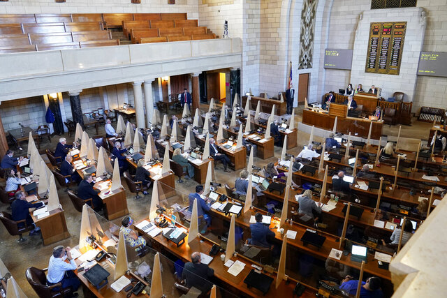 Nebraska state senators vote on a property tax bill in Lincoln, Neb., Tuesday, Aug. 11, 2020. Nebraska lawmakers pushed a property tax package through another procedural vote and were expected to do the same for new abortion restrictions in the session's final days. (AP Photo/Nati Harnik)