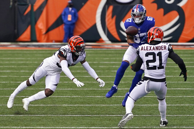 New York Giants wide receiver Sterling Shepard (87) catches a pass during the first half of an NFL football game against the Cincinnati Bengals, Sunday, Nov. 29, 2020, in Cincinnati. (AP Photo/Bryan Woolston)