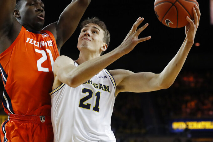 Michigan guard Franz Wagner (21) is defended by Illinois center Kofi Cockburn (21) during the second half of an NCAA college basketball game, Saturday, Jan. 25, 2020, in Ann Arbor, Mich. (AP Photo/Carlos Osorio)