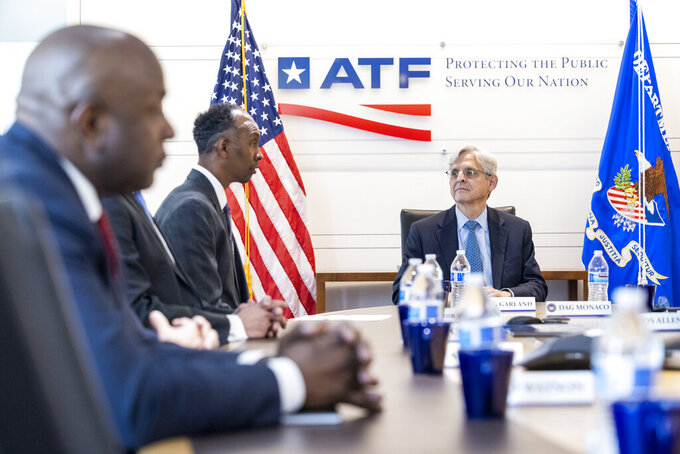 Attorney General Merrick Garland, right, listens as Acting Alcohol, Tobacco and Firearms (ATF) Director Marvin G. Richardson speaks at the Bureau of Alcohol, Tobacco and Firearms headquarters in Washington, Thursday, July 22, 2021. (Jim Lo Scalzo/Pool via AP)