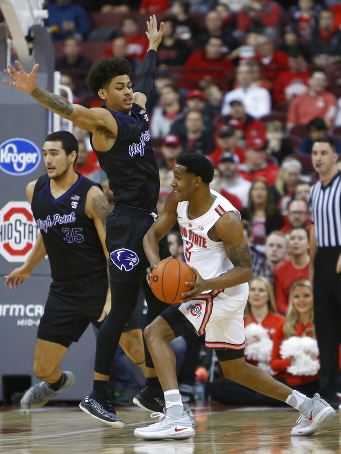 Ohio State's C.J. Jackson, right, looks for an open pass as High Point's Tim Cameron defends during the first half of an NCAA college basketball game Saturday, Dec. 29, 2018, in Columbus, Ohio. (AP Photo/Jay LaPrete)