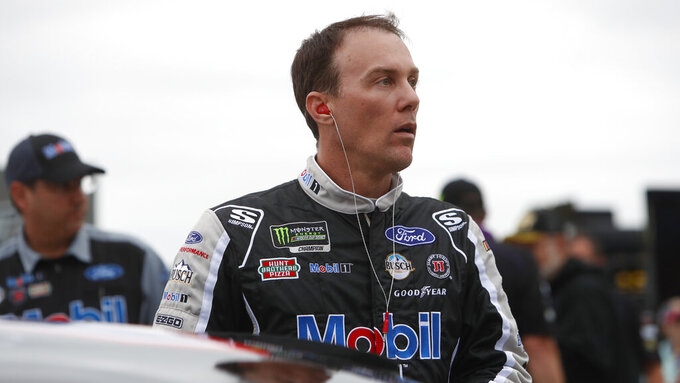 Kevin Harvick prepares to qualify for the NASCAR Cup Series auto race at Texas Motor Speedway in Fort Worth, Texas, Friday, March 29, 2019. Harvick won't be moving to the Fox Sports broadcast booth next year if Darrell Waltrip retires. Harvick said Friday that he's not getting out of the race car and is comfortable where he's at both on and off the track. (AP Photo/LM Otero)