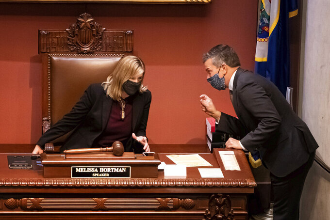 After speaking with Republican legislators on the floor, House Majority Leader Ryan Winkler, DFL-Golden Valley talks with House Speaker Melissa Hortman, DFL-Brooklyn Park, just before the start of a special session, Wednesday, Oct. 14, 2020, in St. Paul, Minn. Democrats are looking for ways to finally pass a bonding bill this year. (Glen Stubbe/Star Tribune via AP)