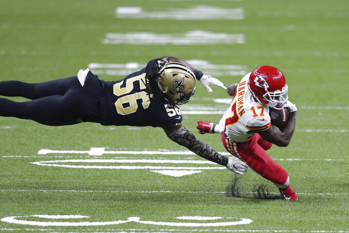 CORRECTS DATE Kansas City Chiefs wide receiver Mecole Hardman (17) caries against New Orleans Saints outside linebacker Demario Davis (56) in the first half of an NFL football game in New Orleans, Sunday, Dec. 20, 2020. (AP Photo/Butch Dill)