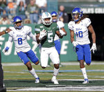 Tulane running back Stephon Huderson (5) goes 55 yards against the Tulsa defense during an NCAA college football game in New Orleans, La., Saturday, Nov. 2, 2019. (A.J. Sisco/The Advocate via AP)