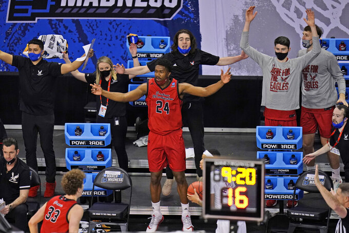 Eastern Washington players react to a play during the first half of a first-round game against Kansas in the NCAA college basketball tournament at Farmers Coliseum in Indianapolis, Saturday, March 20, 2021. (AP Photo/AJ Mast)