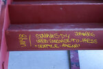 A label written on a stair-step at the Climate Pledge Arena is shown, Tuesday, Sept. 1, 2020, in Seattle, the home of the Seattle Kraken NHL hockey team. Sometime in the late summer or early fall of 2021, the Kraken will open the new facility -- at a cost that will likely total $1 billion by the time it's done -- and become the NHL's 32nd franchise. (AP Photo/Ted S. Warren)