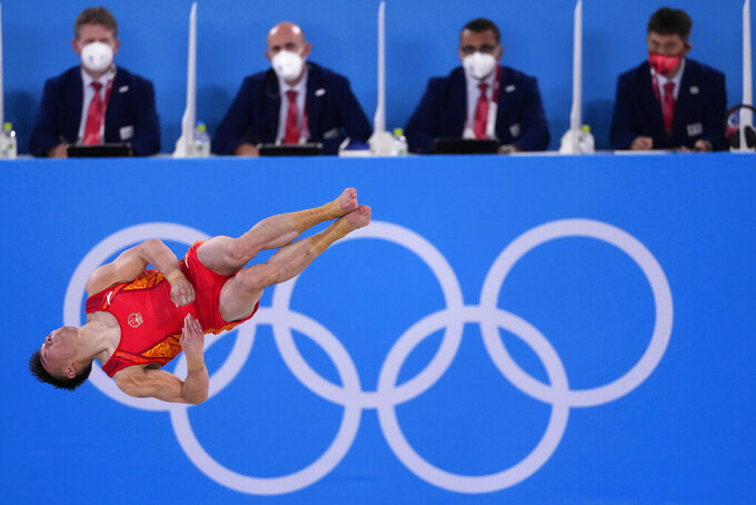 Sun Wei, of China, performs on the floor exercise during the artistic gymnastic men's team final at the 2020 Summer Olympics, Monday, July 26, 2021, in Tokyo. (AP Photo/Ashley Landis)