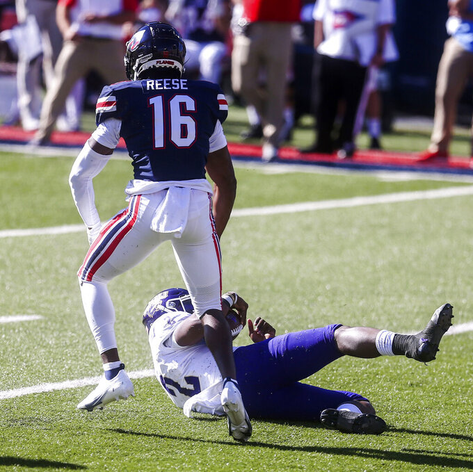 Western Carolina quarterback Mark Wright (2) is sacked by Liberty cornerback Quinton Reese (16) during the first half of an NCAA football game on Saturday, Nov. 14, 2020, in Lynchburg, Va. (AP Photo/Shaban Athuman)