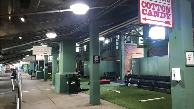 A workout area sits idle in the concourse under the first base stands at Fenway Park, Thursday, July 2, 2020, in Boston. The Boston Red Sox are scheduled resume training camp Friday at Fenway. (AP Photo/Jimmy Golen)