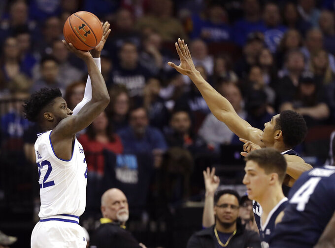 Seton Hall guard Myles Cale (22) shoots a 3-point shot with Villanova forward Jermaine Samuels, right, defending, during the first half an NCAA basketball game, Saturday, March 9, 2019, in Newark, N.J. Cale had 19 points as Seton Hall defeated Villanova 79-75. (AP Photo/Kathy Willens)